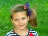 Coletas para niñas peinados para el verano: lateral con lazo