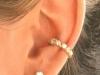 Piercing en la oreja: aro y brillos