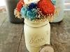 Centros de mesa para bodas botes con flores de papel