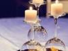 Centros de mesa para bodas copas dadas la vuelta con flores