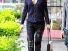 Denim patchwork: look con jeans negros con parches