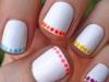 Diseños de uñas fáciles y bonitos manicura blanca con lunares de colores