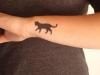 Tatuajes mascotas: gato silueta negra