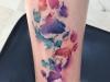 Tatuajes mascotas: perro huellas de colores