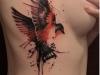 Tatuajes en el costado para mujer: Fénix