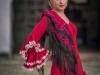 Vestidos de flamenca 2017: MiAbril modelo rojo con mantón